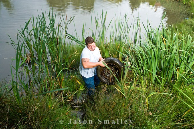 removing rubbish, a tyre from a pond (Jason Smalley)
