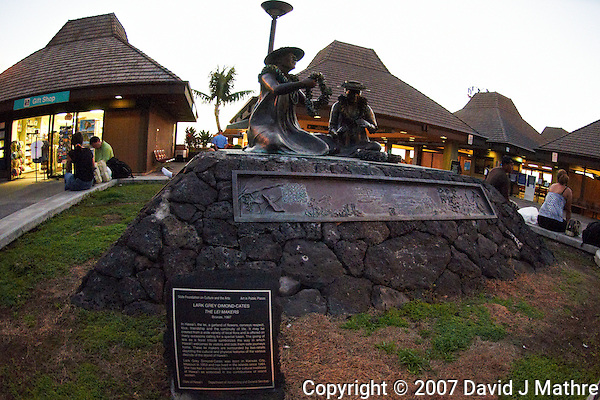 "Kona International Airport Waiting Area. Bronze of ""The Lei Makers"" Image taken with a Nikon D300 and 10.5 mm f/2.8 fisheye lens (ISO 1400, f/2.8, 1/125 sec). (David J Mathre)"