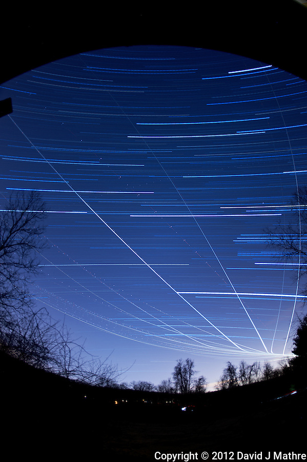 Winter Sky Star and Jet Trails. Image taken with a Nikon D700 and 16 mm f/2.8 fisheye lens (ISO 200, f/2.8, 300 sec). Composite of 35 images processed with Startrails program. (David J. Mathre)