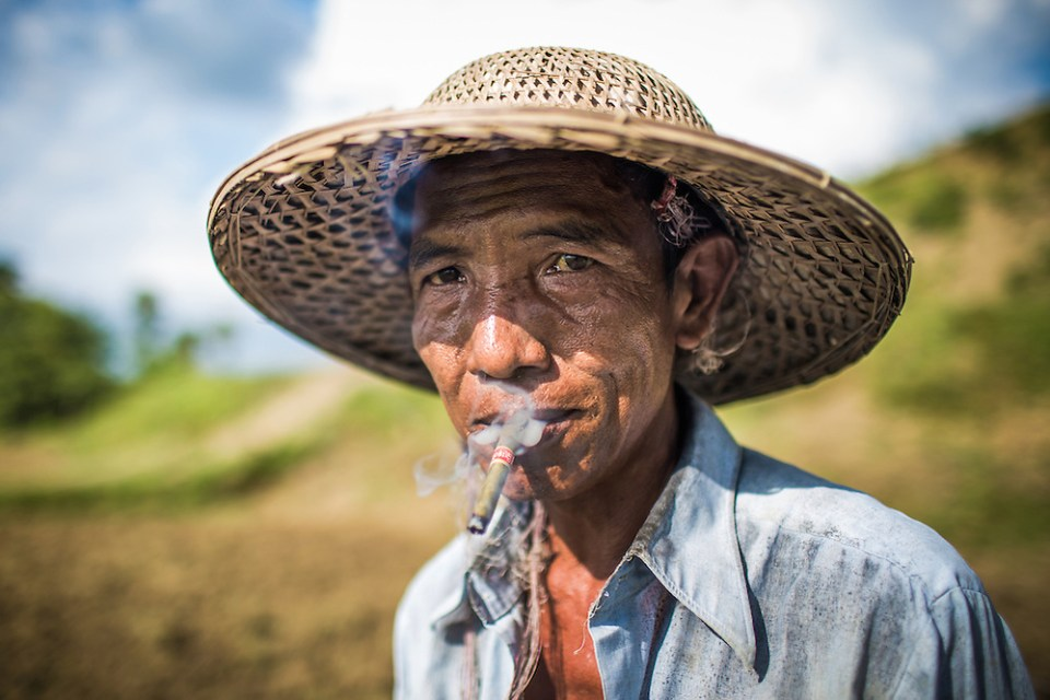 A farmer from the Magwe Region of Myanmar takes a break from the extreme heat to chat to me in his basic English, which he learned by himself. (Paul Ratje)