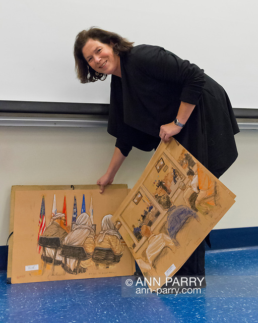 """Hempstead, NY, U.S. November 12, 2013. Janet Hamlin, a courtroom artist covering the military tribunals at Guantanamo Bay since 2006, shows her charcoal drawings and discusses her work at Hofstra University. Much of the time she was the only journalist providing a visual record of the events at the United States naval base in Cuba, and her new book"