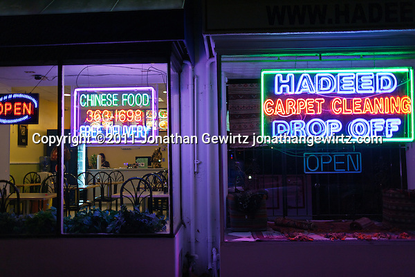 Night view of a carpet store and restaurant with bright neon signs. (Copyright 2011 Jonathan Gewirtz jonathan@gewirtz.net)