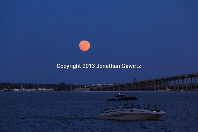 The full moon rises over Virginia Key and the William Powell Bridge in Biscayne Bay at Miami. (Jonathan Gewirtz   jonathan@gewirtz.net)