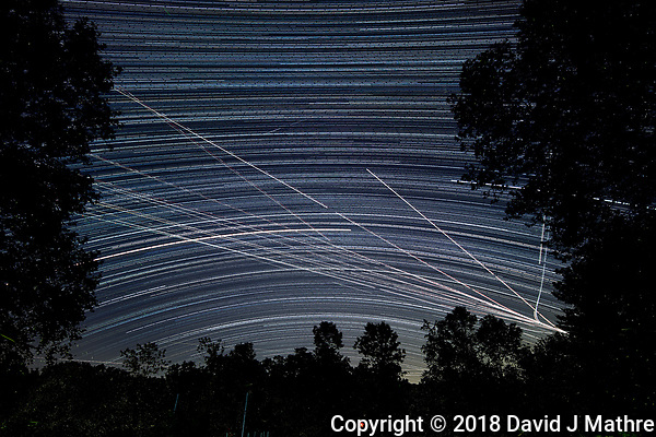 Star Trails Looking South (23:00-03:59). Composite of image taken with a Nikon D850 camera and 19 mm f/4 PC-E lens (ISO 200, 19 mm, f/4, 30 sec). Raw images processed with Capture One Pro and the composite generated with Photoshop CC (statistics, maximum). (DAVID J MATHRE)