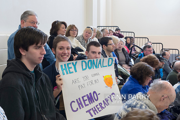 "Westbury, New York, USA. January 15, 2017. BRIDGIT SQUITIRE, of West Islips holds a sign asking ""HEY DONALD, ARE YOU GONNA PAY FOR MY CHEMO-THERAPY?"" at the ""Our First Stand"" Rally against Republicans repealing the Affordable Care Act, ACA, taking millions of people off health insurance, making massive cuts to Medicaid, and defunding Planned Parenthood. Hosts were Reps. K. Rice (Democrat - 4th Congressional District) and T. Suozzi (Dem. - 3rd Congress. Dist.). It was one of dozens of Bernie Sanders' rallies nationwide for health care that Sunday. (Ann Parry/Ann Parry, ann-parry.com)"