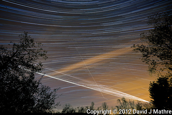 Southern backyard view of the night sky. Star trails, jet trails, and clouds. Composite of 180 images taken with a Nikon D800 camera and 14-24 mm f/2.8 lens (ISO 100, 14 mm, f/2.8, 59 sec). (David J Mathre)