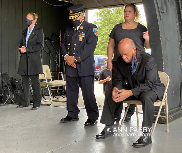 East Meadow, New York, U.S. September 10, 2020. At far right, PATRICK J. RYDER, Commissioner of the Nassau County Police Department, is seated on side of stage as Nassau County commemorates 19th anniversary of September 11 terrorist attacks with Remembrance Ceremony at Eisenhower Park. (© 2020 Ann Parry/AnnParry.com)