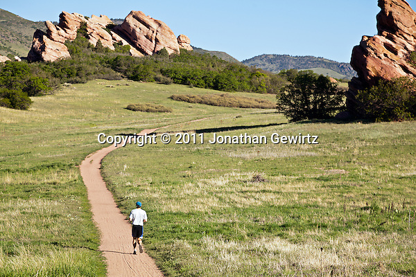 A runner on a path winding through red rock outcroppings in the South Valley Park Ken-Caryl Ranch Open Space in Colorado. (Jonathan Gewirtz)
