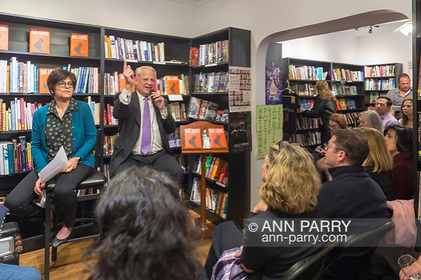 Rockville Centre, NY, USA. April 201, 2018. Sitting facing audience, Rep. STEVE ISRAEL speaks at event for the former Congressman's newest novel BIG GUNS, at Turn of the Corkscrew Books & Wine. Left of Israel is Moderator RITA KESTENBAUM. (© 2018 Ann Parry/Ann-Parry.com)