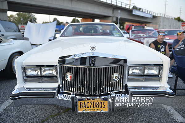 Bellmore, New York, USA. August 24, 2018. Hundreds of classic and custom cars are on display at Bellmore Friday Night Car Show, in parking lot of LIRR Bellmore station. This traditional Long Island event is hosted by the Chamber of Commerce of the Bellmores. (Ann Parry/Ann Parry, ann-parry.com)