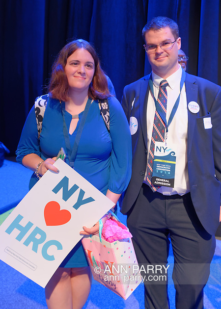Hempstead, NY, USA. May 23, 2018. Delegate, the president of her Democratic club, is holding 'NY heart-symbol HRC' poster in convention hall during Day 1 of New York State Democratic Convention at Hofstra University. (© 2018 Ann Parry/Ann-Parry.com)