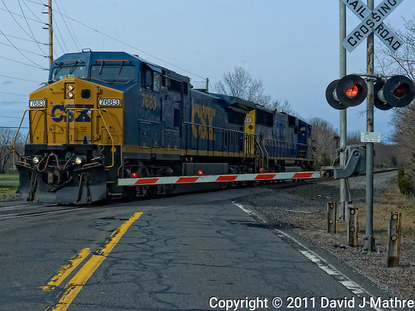 CSX 7683 Engine at Local Rail Road Crossing in Skillman, New Jersey. Snapshot taken with Leica D-Lux 5 (ISO 100, 14.9 mm, f/4.5, 1/800 sec). (David J Mathre)