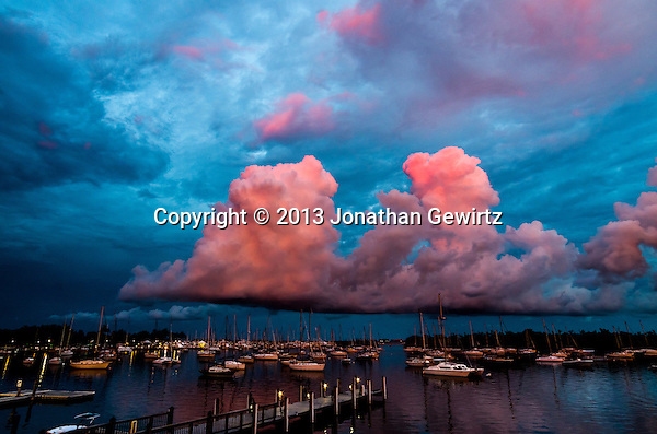 Reflected light from the setting sun paints low clouds over the marina at the Coconut Grove Sailing Club, Miami, Florida. (Jonathan.Gewirtz@gmail.com)