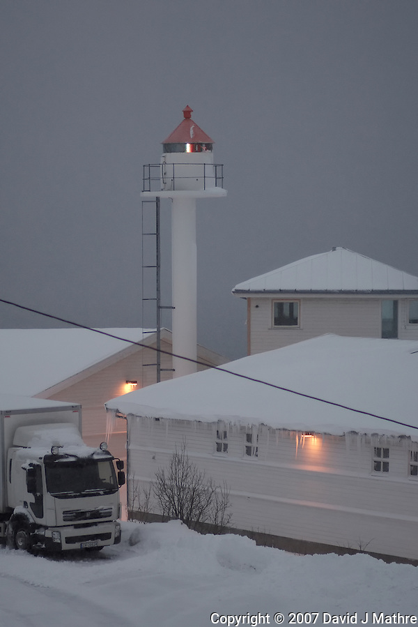Winter View of the Finnsnes Lighthouse in a Snowstorm. Image taken with a Nikon D2xs and 85 mm f/1.4 lens (ISO 200, 85 mm, f/1.4, 1/400 sec). (David J Mathre)