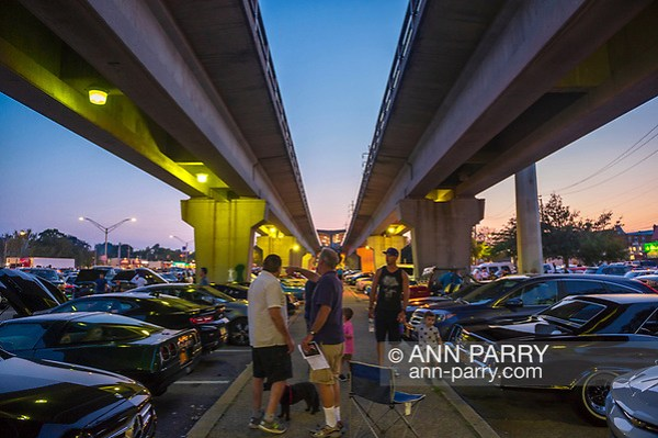 Bellmore, New York, USA. August 24, 2018. At the Bellmore Friday Night Car Show, many cars and visitors are under the overhead tracks at the Bellmore LIRR train station. (Ann Parry/Ann Parry, ann-parry.com)