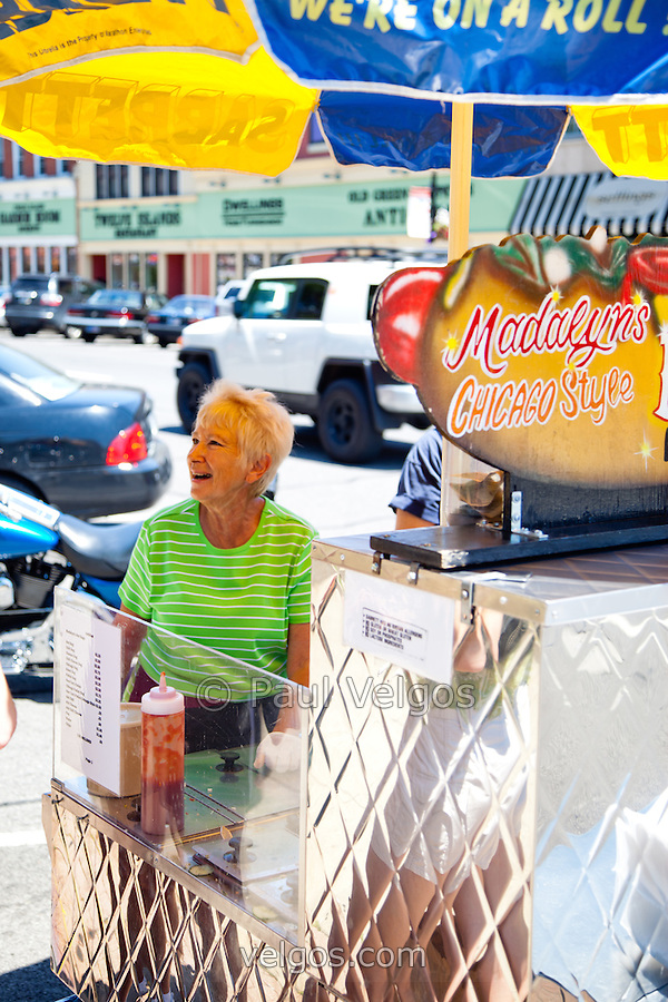 "Madalyn the Hot Dog Lady of Crown Point Indiana in 2010. Sadly, Madalyn hasn't been in the square for the summer of 2011 and has apprantly retired. She was a part of life in Crown Point for a long time and will be missed. Crown Point is located in Northwest Indiana with a population of over 37,000. Crown Point and Lake County are about 50 miles from Chicago and are considered part of the ""Chicagoland"" area. Crown Point has a traditional small town America feel with a main street consisting of the old Lake County Courthouse surrounded by numerous small businesses, known as ""the square"", including a theater, ice cream shop, antique stores, and restaurants. (Paul Velgos)"