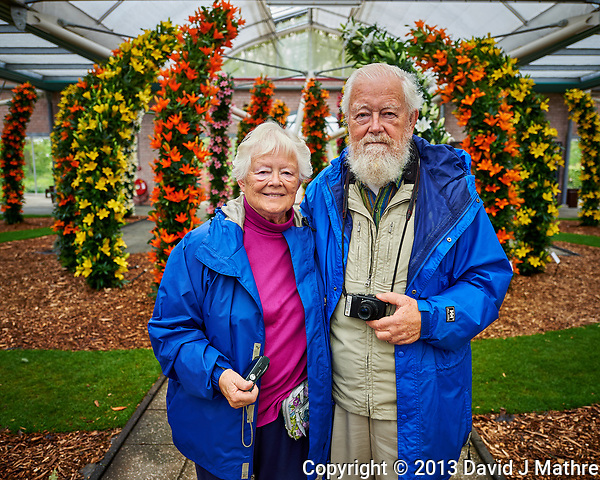Joan and Loren at the Lily arch. Tulip festival at Keukenhof Gardens in Lisse, Netherlands. Image taken with a Nikon D4 camera and 14-24 mm f/2.8 lens. (David J Mathre)