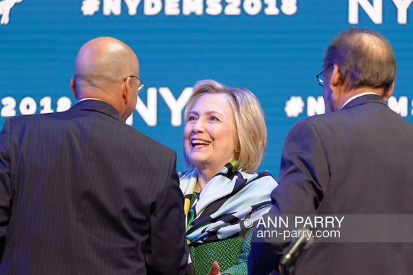 Hempstead, New York, USA. May 23, 2018. HILLARY CLINTON greets GEOFF BERMAN, Executive Director of New York State Democratic Committee, as she goes on stage to deliver Keynote Address during Day 1 of New York State Democratic Convention, held at Hofstra University on Long Island. (Ann Parry/Ann Parry, ann-parry.com)