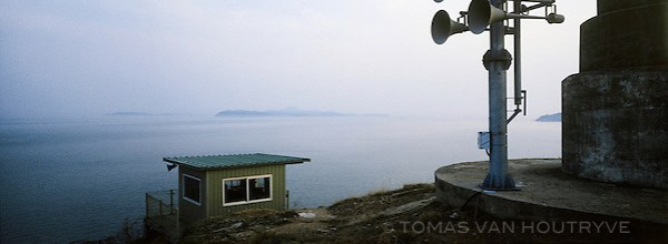 Attack warning sirens are seen near a guard post overlooking the Yellow Sea on Baengnyeong Island, South Korea on April 18, 2012. When an armistice ended open conflict on the Korean peninsula in 1953, there was no agreed upon boundary set up in the Yellow Sea between the two Koreas. Each side has drawn their own line, the South Korean controlled islands of Yeonpyeong, Baengnyeong and Daecheong are located between the two disputed lines. (Tomas van Houtryve/VII)