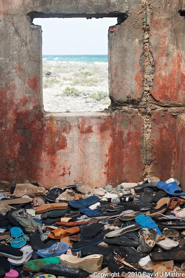 Flip Flop Lost and Found on Bonaire. ISE/SAS Spring 2010 Enrichment Caribbean Voyage, Nikonians Ultimate Travel Workshop. UTW-I Day 9: Bonaire. Image taken with a Nikon D3x and 50 mm f/1.4G lens (ISO 100, 50 mm, f/5.6, 1/30 sec). (David J Mathre)