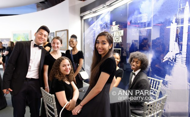 Garden City, New York, U.S. June 6, 2019. Freeport High School Select Chorale members, wearing formal black suits and evening dresses, gather before they perform during Apollo at 50 Anniversary Dinner at Cradle of Aviation Museum, an Apollo astronaut tribute celebrating the Apollo 11 mission Moon landing. (© 2019 Ann Parry/Ann-Parry.com)