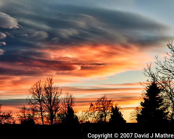 Orange and Black Clouds Over Boulder. Image taken with a Nikon D300 camera and 17-35 mm f/2.8 lens (ISO 200, 35 mm, f/11, 1/8 sec). (David J Mathre)