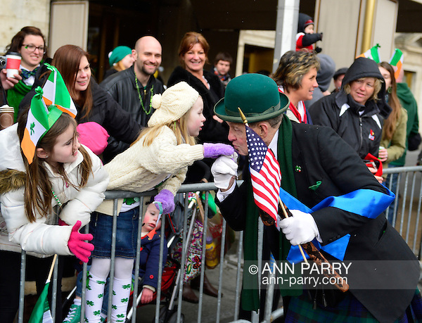 March 16, 2013 - New York, NY, U.S. -'Leprechaun' NOEL RYAN, an alumnus of Quinnipiac College, kisses hand of young girl in crowd at the 252nd annual NYC St. Patrick's Day Parade. Thousands of marchers show their Irish pride, as they march up Fifth Avenue, and over a million people, often in green and orange, watch and celebrate. (Ann Parry/Ann Parry, ann-parry.com)
