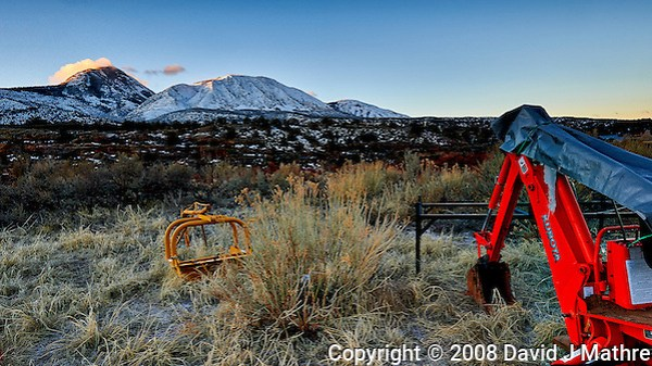 Sleeping Ute Mountain and red back-hoe on an early winter morning at Kelley's Place near Cortez, Colorado. Image taken with a Nikon D3 camera and 14-24 mm f/2.8 lens (ISO 200, 22 mm, f/16, 1/10 sec). (David J Mathre)