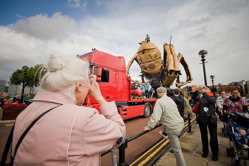 Thursday and La Princess is transported across the city to Albert Dock.  Everyone is looking out their office windows and taking to the streets to see the spider. (Pete Carr)