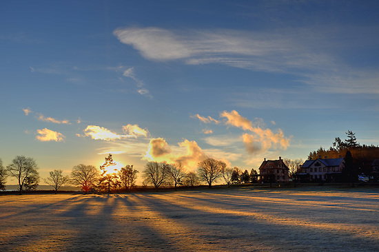 Sun rises over parade grounds, Fort Worden State Park, Port Townsend, Washington, USA (Brad Mitchell)