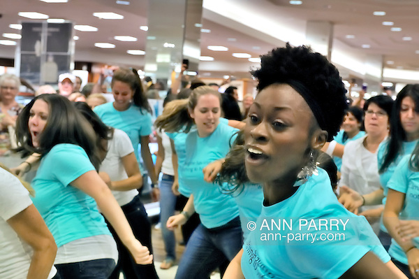 "Flash Mob dance event for Estee Lauder at Macy's in Long Island, New York, USA, on July 23, 2011. Teal shirts dancers wearing have ""Imagine having nothing to hide"" written on front. (Ann E Parry/Ann Parry, Ann-Parry.com)"