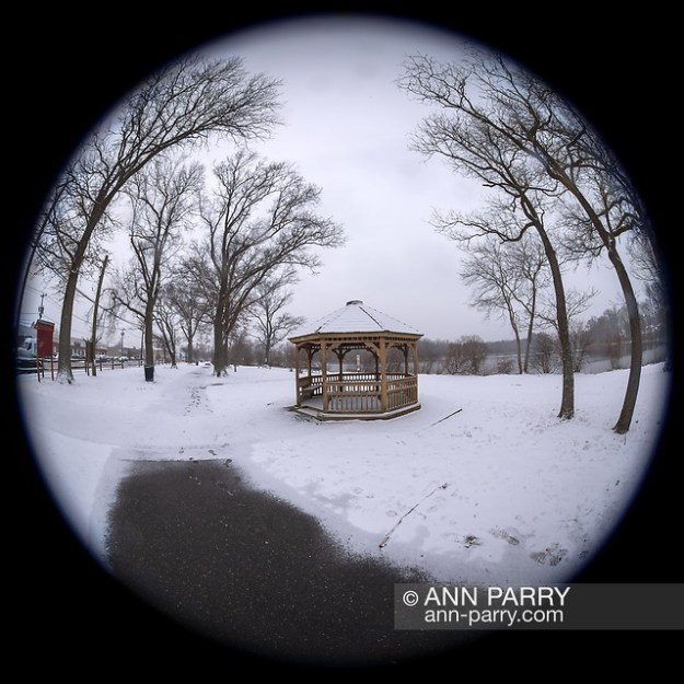 Wantagh, New York, USA. February 20, 2019. Snow falls at Mill Pond Park, with partly shoveled path leading to wood gazebo on Long Island. 180 degree fisheye view of Nassau County public park. (© 2019 Ann Parry/Ann-Parry.com)