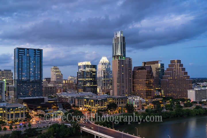 We took the images from early evening around dusk after the lights came on the buildings in downtown Austin.  You can see the usual high-rises like the Frost, W hotel, Austonian, all along the shore line of Lady Bird Lake (Tod Grubbs & Cynthia Hestand)