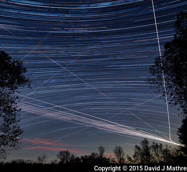 Star and jet trails. Southern night sky view from my backyard. Composite of images taken with a Nikon D810a camera and 14-24 mm f/2.8 lens (ISO 200, 14 mm, f/4, 120 sec). (David J Mathre)