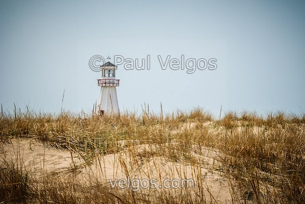 Photo of New Buffalo  lighthouse with beach sand grass in New Buffalo Michigan. (Paul Velgos)