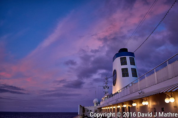 Pink clouds over the MV World Odyssey at dawn. Semester at Sea, 2016 Spring Semester Voyage. Day 3 of 102. Image taken with a Leica T camera and 23 mm f/2 lens (ISO 400, 23 mm, f/3.5, 1/30 sec). (David J Mathre)