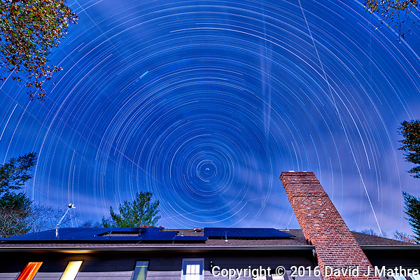 Startrails looking north (light clouds). The north star isn't exactly due north. Composite of 130 images taken with a Nikon D810a camera and 14-24 mm f/2.8 lens (ISO 200, 14 mm, f/8, 300 sec). (David J Mathre)