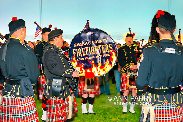 Fundraiser for firefighter Ray Pfeifer - battling cancer after months of recovery efforts at Ground Zero following 9/11 2001 Twin Towers attack - draws supporters from New York, Massachusetts and more, on Saturday, March 31, 2012, at East Meadow Firefighters Benevolent Hall, New York, USA. The Nassau County Firefighters Pipes and Drums band performed. [NOTE: Background tent color altered digitally to blue] (Ann Parry/Ann Parry, ann-parry.com)