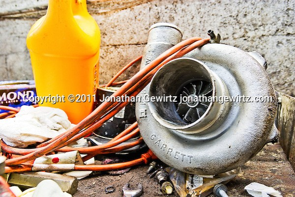 A broken turbocharger on a work bench. (© Jonathan Gewirtz, jonathan@gewirtz.net)