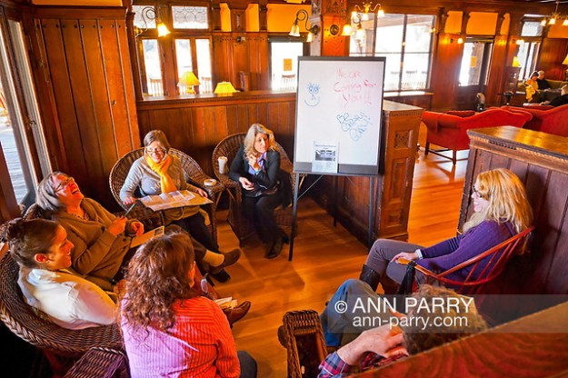 New Paltz, NY, U.S. March 10, 2012. Mohonk Murder Mystery Weekend team meeting of Sam's Piano Players - with my daughter LAURIE GRAB at extreme right, and actress ALLEY MAURAIN, to left of easel board - meets in Lake Lounge of Mohonk Mountain House. (© 2010 Ann Parry/Ann-Parry.com)
