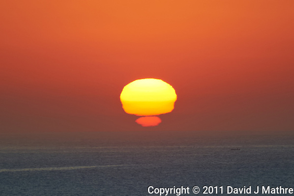 Fisherman at Sunrise while at Anchor off Cabo San Lucas Mexico. Image taken with a Nikon D3s and 70-300 mm VR lens (ISO 200, 300 mm, f/5.6, 1/64</div> <div  _mce_tmp=