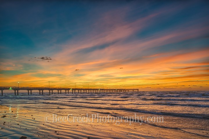 Another great sunrise on the beach on the Texas Coast in Port Aransas where the surf was calm and the skies were full of vivid colors this day with the fishing pier in the distance. (Tod Grubbs & Cynthia Hestand)