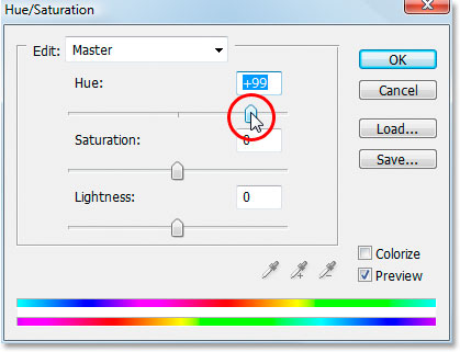 Dragging the 'Hue' slider in the 'Hue/Saturation' dialog box.