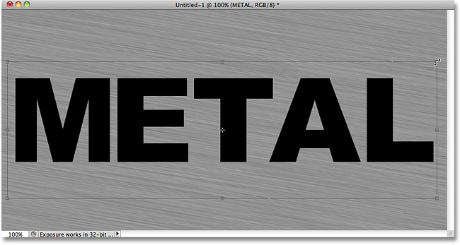 Moving and resizing the text with Free Transform. Image © 2010 Photoshop Essentials.com.