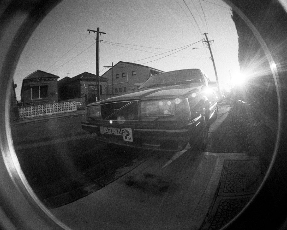 Volvo in sunshine | Lomography Fisheye 2 | Ilford HP5 Plus