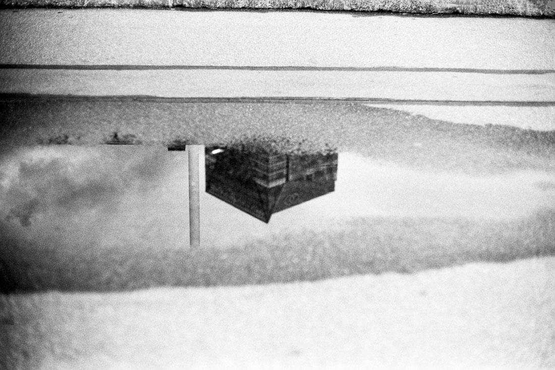 Building in a puddle | Pentax Spotmatic SP | Pentax Super-Takumar 50mm f/1.4 |Ilford FP4 Plus