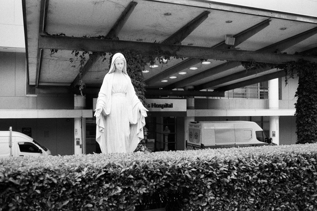 Virgin Mary outside hospital | Pentax Spotmatic SP | Pentax Super-Takumar 35mm f/3.5 | Ilford HP5 Plus