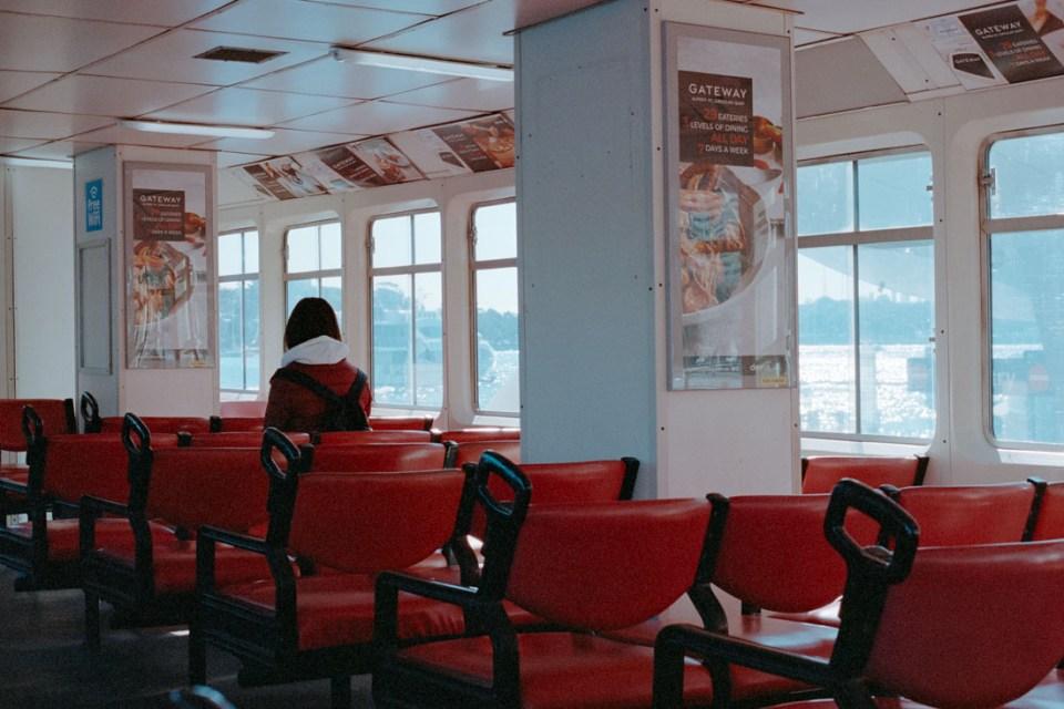 Alone on ferry | Nikon F100 | Nikkor 50mm 1:1.8 AF-S G | Kodak Portra 400