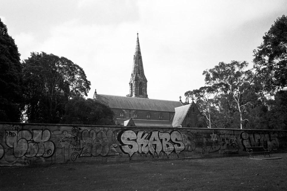 Church behind graffiti | Mamiya Press Super 23 | Sekor Seikosha-S 65mm f/6.3 | Kodak Tri-X