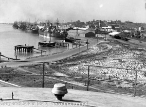 Looking east across Newcastle from oil storage tanks, circa 1930s.